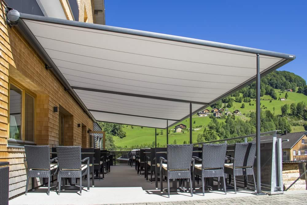 awnings project awning img opened co partially shade retractable mounted northwest roof