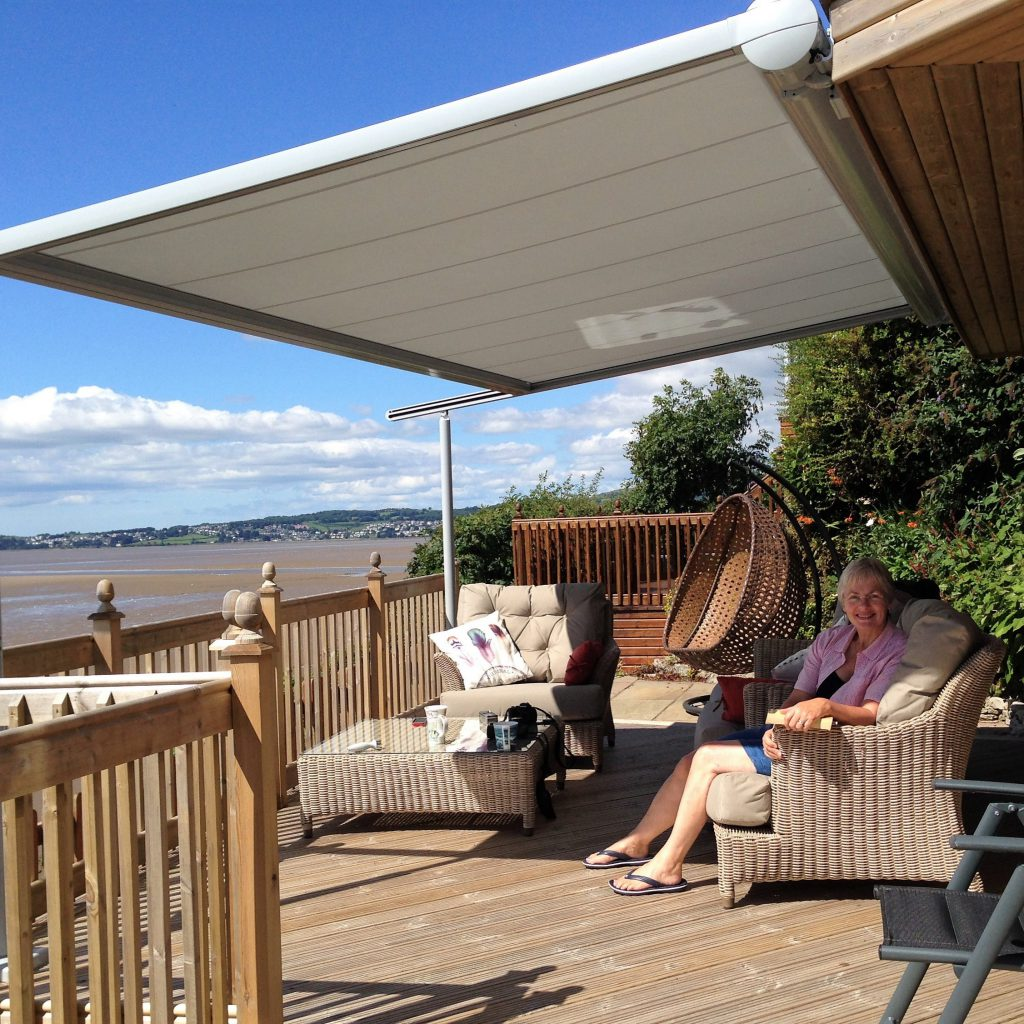 Customer sitting under her Markilux Pergola 110 in Cumbria